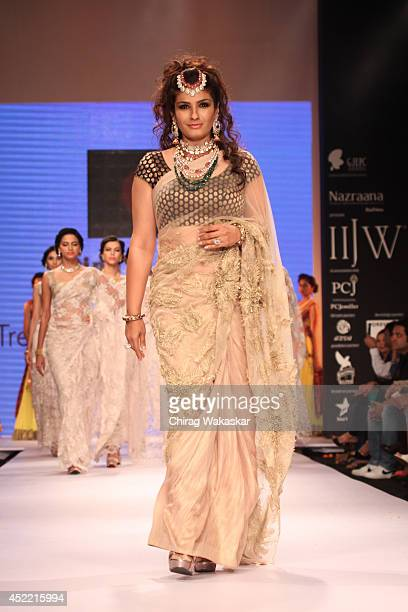 Raveena Tandon walks the runway at the Dipti Amisha show during day 2 of the India International Jewellery Week 2014 at grand Hyatt on July 15 2014...