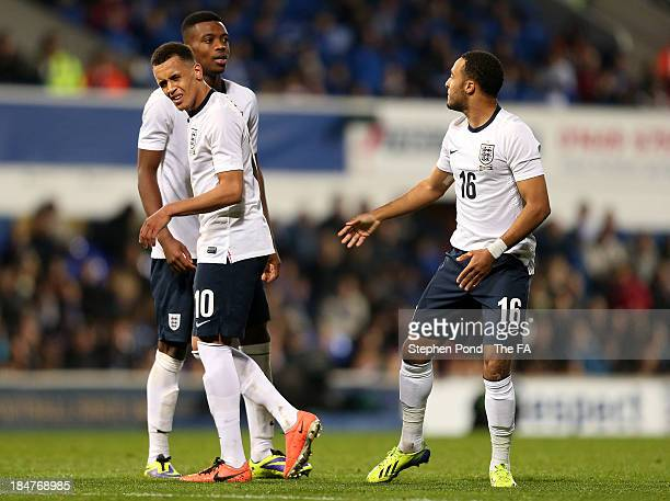 Ravel Morrison of England has words with teammate Nathan Redmond during the 2015 UEFA European U21 Championships Qualifying Group One match between...