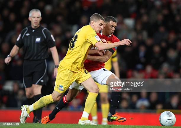 Ravel Morrison of Manchester United clashes with Stuart O'Keefe of Crystal Palace during the Carling Cup Quarter Final match between Manchester...