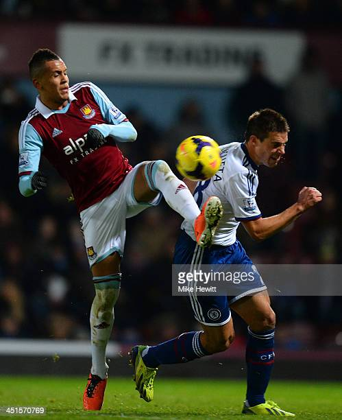 Ravel Morrison of West Ham and Cesar Azpilicueta of Chelsea battle for the ball during the Barclays Premier League match between West Ham United and...
