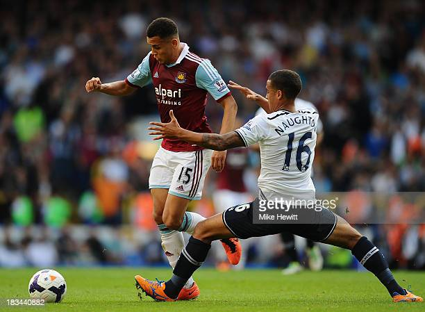 Ravel Morrison of West Ham avoids the tackle of Kyle Naughton of Tottenham during the Barclays Premier League match between Tottenham Hotspur and...