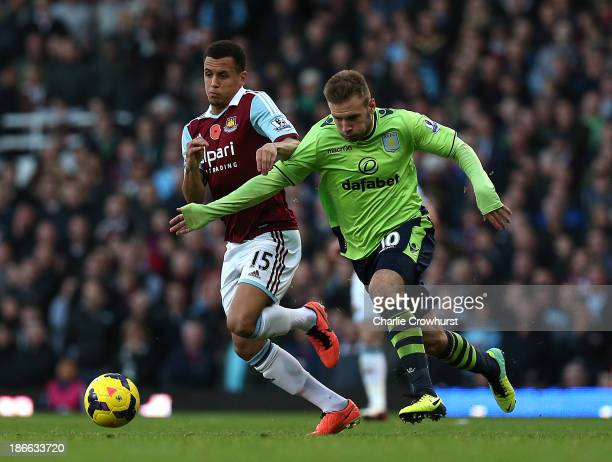 Ravel Morrison of West Ham holds off the tackle from Andreas Weimann of Villa during the Barclays Premier League match between West Ham United and...