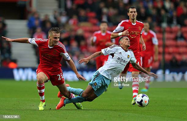 Ravel Morrison of West Ham is brought down by Luke Shaw of Southampton during the Barclays Premier League match between Southampton and West Ham...