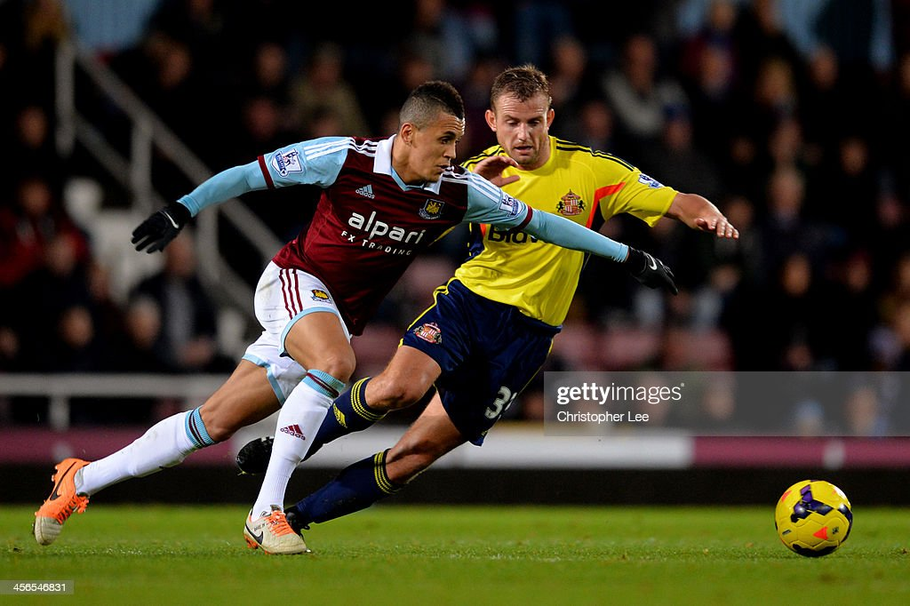 <a gi-track='captionPersonalityLinkClicked' href=/galleries/search?phrase=Ravel+Morrison&family=editorial&specificpeople=5621330 ng-click='$event.stopPropagation()'>Ravel Morrison</a> of West Ham is challenged by <a gi-track='captionPersonalityLinkClicked' href=/galleries/search?phrase=Lee+Cattermole&family=editorial&specificpeople=646988 ng-click='$event.stopPropagation()'>Lee Cattermole</a> of Sunderland during the Barclays Premier League match between West Ham United and Sunderland at Boleyn Ground on December 14, 2013 in London, England.