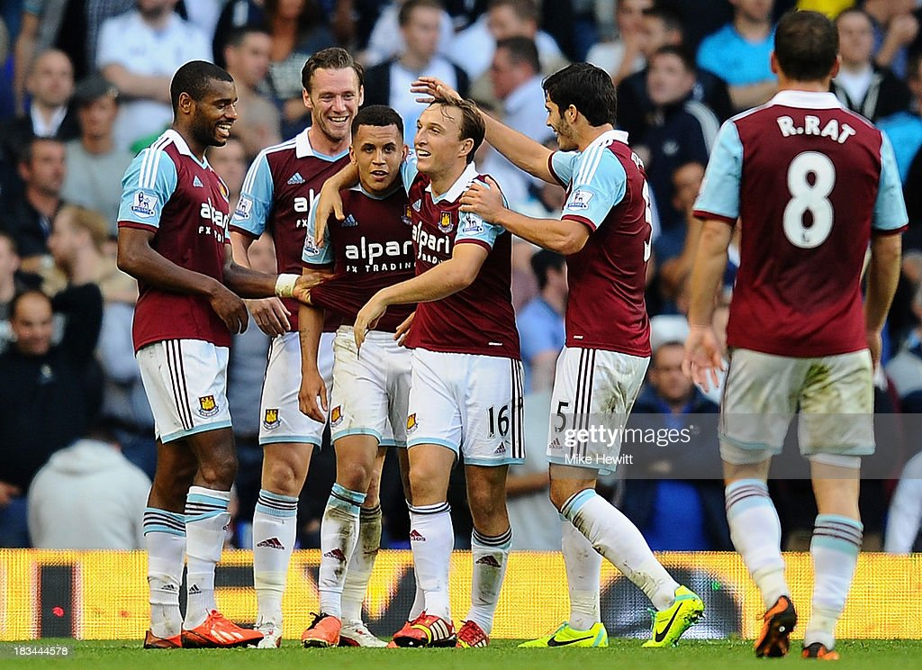 <a gi-track='captionPersonalityLinkClicked' href=/galleries/search?phrase=Ravel+Morrison&family=editorial&specificpeople=5621330 ng-click='$event.stopPropagation()'>Ravel Morrison</a> of West Ham (3L) is congratulated by team mates after scoring his side's third goal during the Barclays Premier League match between Tottenham Hotspur and West Ham United at White Hart Lane on October 6, 2013 in London, England.