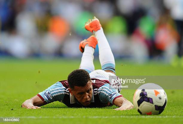 Ravel Morrison of West Ham slides along the ground after being tackled during the Barclays Premier League match between Tottenham Hotspur and West...