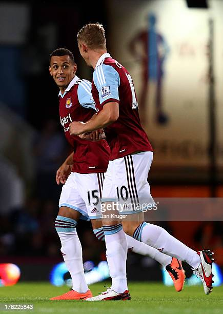 Ravel Morrison of West Ham United celebrates with teammate Jack Collison after scoring their second goal during the Capital One Cup second round...