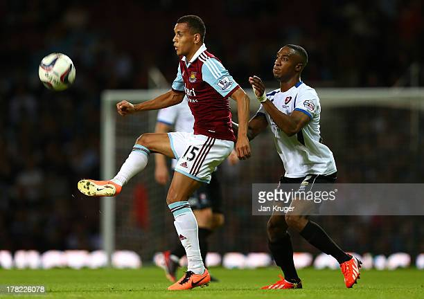 Ravel Morrison of West Ham United controls the ball from Craig BrahamBarrett of Cheltenham Town during the Capital One Cup second round match between...