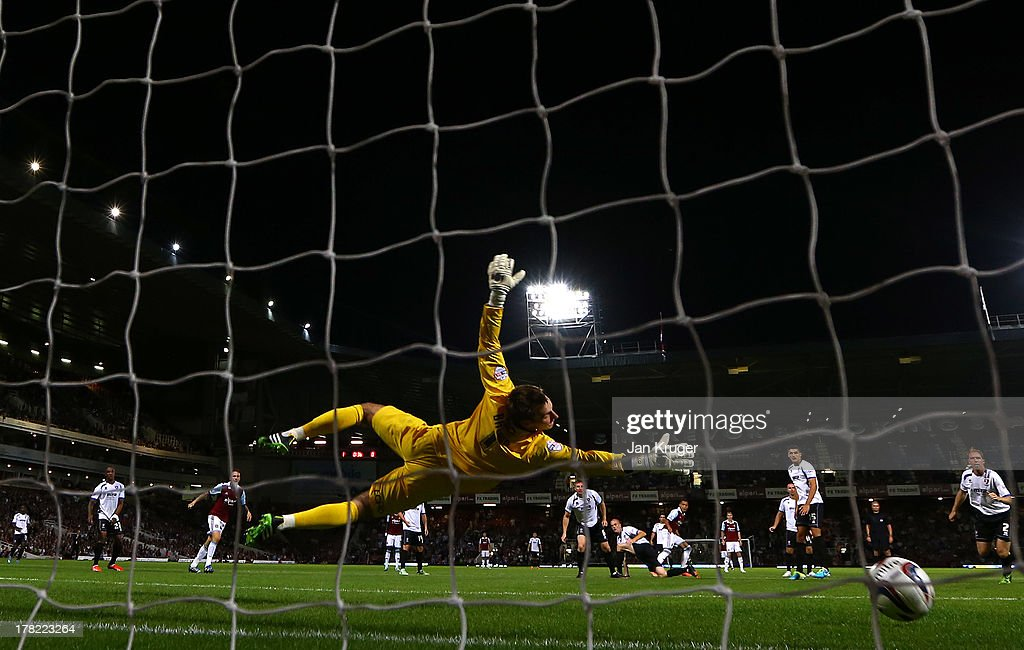 Ravel Morrison (6th L) of West Ham United shoots past goalkeeper Scott Brown of Cheltenham Town to score their second goal during the Capital One Cup second round match between West Ham United and Cheltenham Town at The Boleyn Ground on August 27, 2013 in London, England.