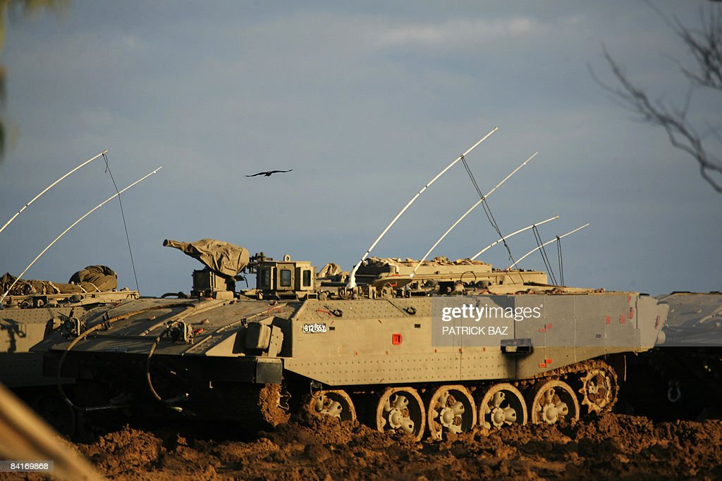 A raven flies over an Israeli army Armoured Personnel Carrier at the Israeli border with the Gaza Strip on January 3 2009 The Israeli military has...