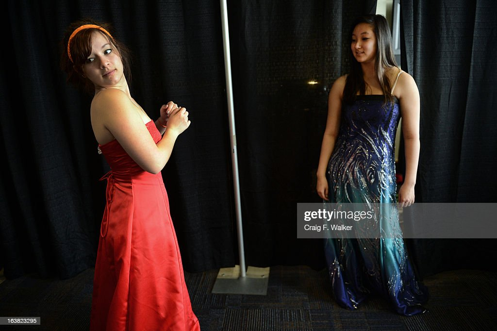 Raven Gereaux, left, and Allison Okita, both seniors at Legacy High School, try on dresses during the Prom Dress Exchange Corp. event in Commerce City, CO March 16, 2013. With a valid student ID and a suggested $10 donation, teenage girls could chose from 1,356 donated dresses that lined a long hallway at Dick's Sporting Goods Park. Gereaux said, 'prom is so expensive already, I think it's a great opportunity for girls to get a really nice dress for a reasonable price.'