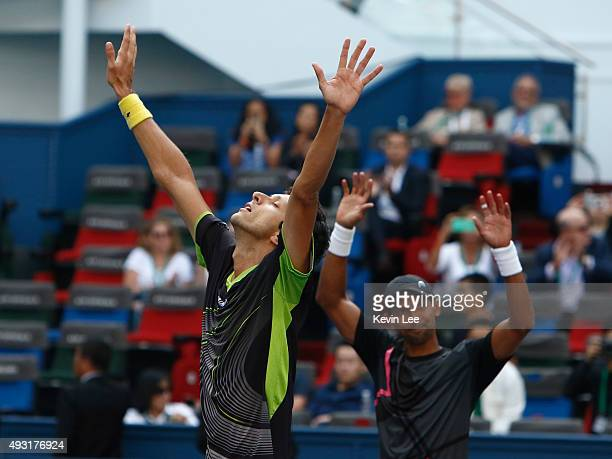 Raven Klaasen of Republic of South Africa and Marcelo Melo of Brazil react after winning the match against Simone Bolelli of Italy and Fabio Fognini...