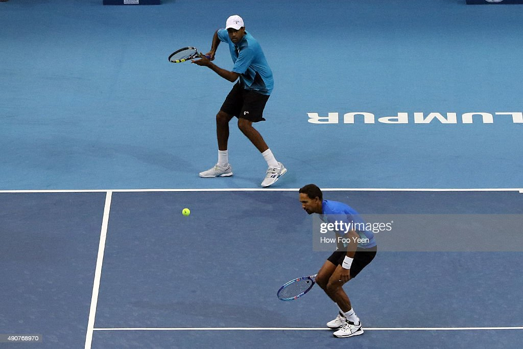 Raven Klaasen of RSA and Rajeev Ram of USA competes against Rameez Junaid of Australia and Jonathan Marray of Germany during the 2015 ATP Malaysian...