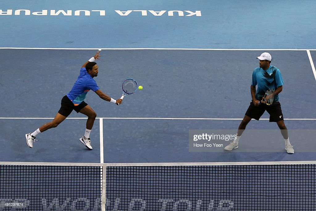 <a gi-track='captionPersonalityLinkClicked' href=/galleries/search?phrase=Raven+Klaasen&family=editorial&specificpeople=5692209 ng-click='$event.stopPropagation()'>Raven Klaasen</a> of RSA and <a gi-track='captionPersonalityLinkClicked' href=/galleries/search?phrase=Rajeev+Ram&family=editorial&specificpeople=2089360 ng-click='$event.stopPropagation()'>Rajeev Ram</a> of USA competes Treat Huey of Phillipines and Henri Kontinen of Finland during the 2015 ATP Malaysian Open at Bukit Jalil National Stadium on October 4, 2015 in Kuala Lumpur, Malaysia.