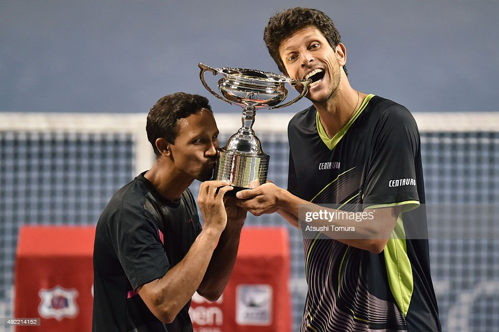 Raven Klaasen of South Africa and Marcelo Melo of Brazil celebrate with the trophy after winning the men's doubles final match against Juan Sebastian Cabal of Colombia and Robert Farah of Colombia on Day Seven of the Rakuten Open 2015 at Ariake Colosseum on October 11, 2015 in Tokyo, Japan.