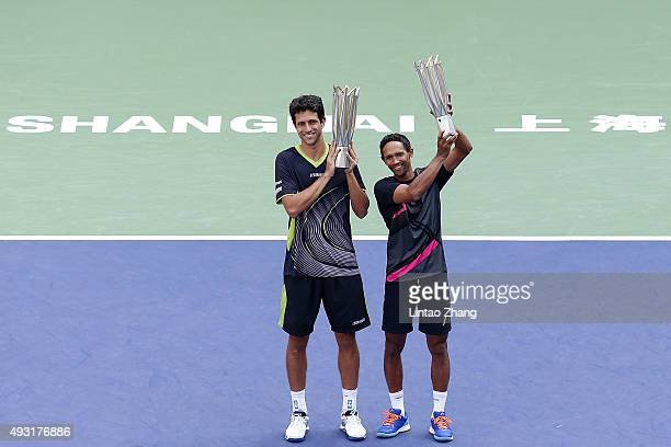 Raven Klaasen of South Africa and Marcelo Melo of Brazil pose with their trophy after winning the Men's doubles final match on day 8 of Shanghai...