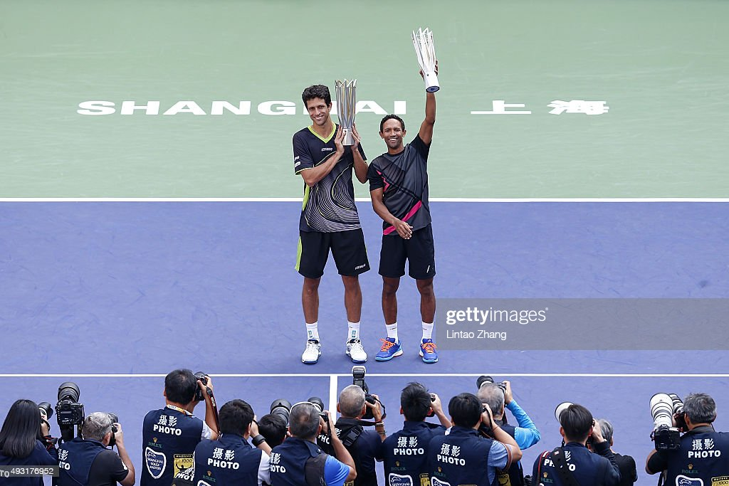 Raven Klaasen (R) of South Africa and Marcelo Melo (L) of Brazil pose with their trophy after winning the Men's doubles final match on day 8 of Shanghai Rolex Masters at Qi Zhong Tennis Centre on October 18, 2015 in Shanghai, China.