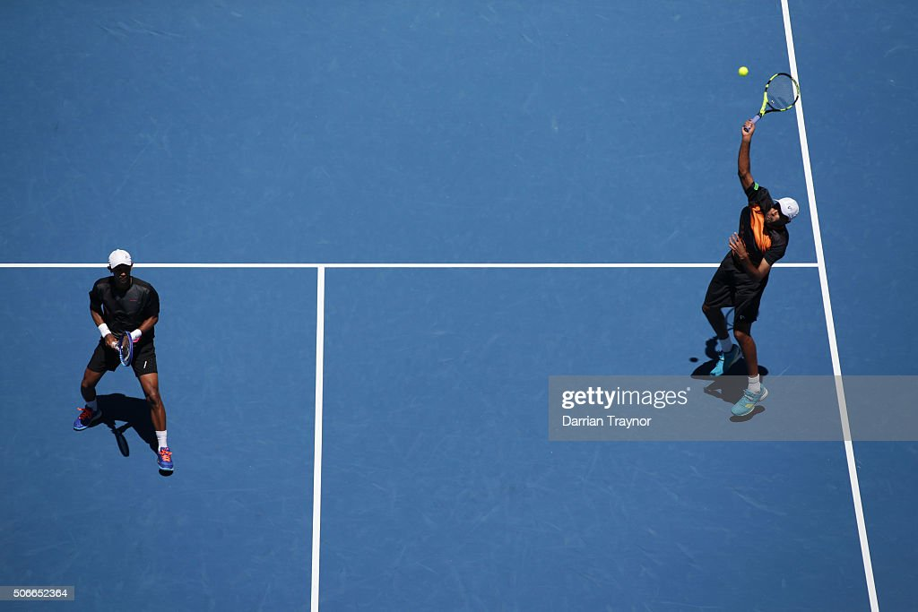 Raven Klaasen of South Africa and Rajeev Ram of the United States comepete in their third round match against Bob Bryan and Mike Bryan of the United...