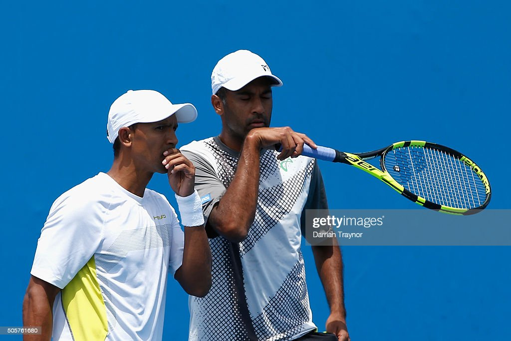 Raven Klaasen of South Africa and Rajeev Ram of the United States talk tactics in their first round match against Marcus Daniell and Artem Sitak of...