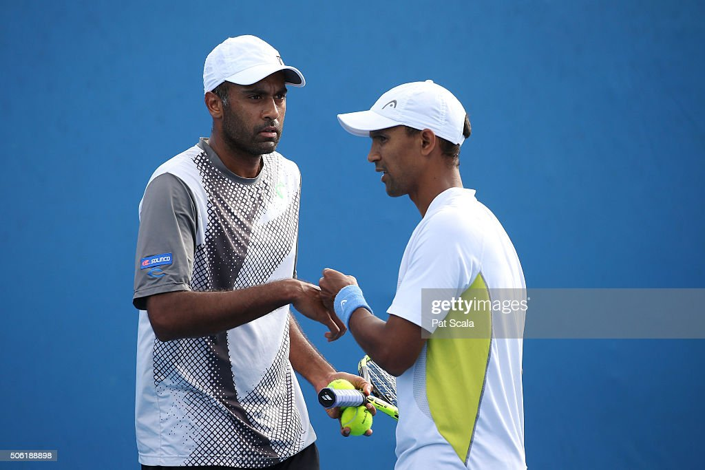 Raven Klaasen of South Africa and Rajeev Ram of the United States talk tactics during their second round doubles match against Sam Querrey and Steve...