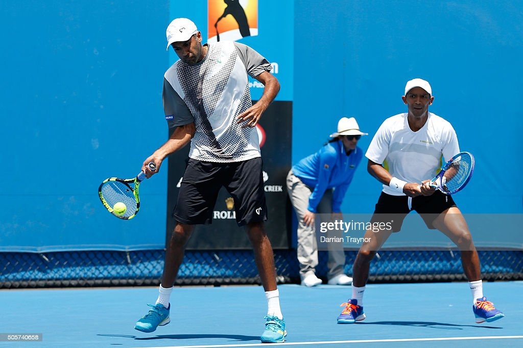 <a gi-track='captionPersonalityLinkClicked' href=/galleries/search?phrase=Raven+Klaasen&family=editorial&specificpeople=5692209 ng-click='$event.stopPropagation()'>Raven Klaasen</a> of South Arica and <a gi-track='captionPersonalityLinkClicked' href=/galleries/search?phrase=Rajeev+Ram&family=editorial&specificpeople=2089360 ng-click='$event.stopPropagation()'>Rajeev Ram</a> of the United States compete in their first round match against Marcus Daniell and Artem Sitak of New Zealand during day three of the 2016 Australian Open at Melbourne Park on January 20, 2016 in Melbourne, Australia.
