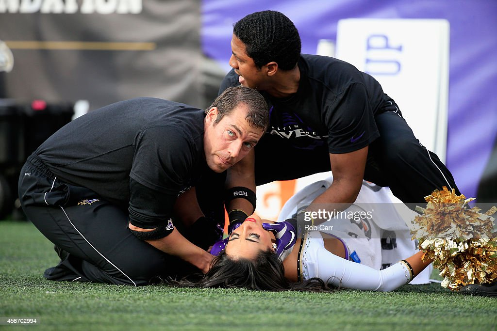 Ravens cheerleader is tended to after falling during a game between the Baltimore Ravens and Tennessee Titans at MT Bank Stadium on November 9 2014...