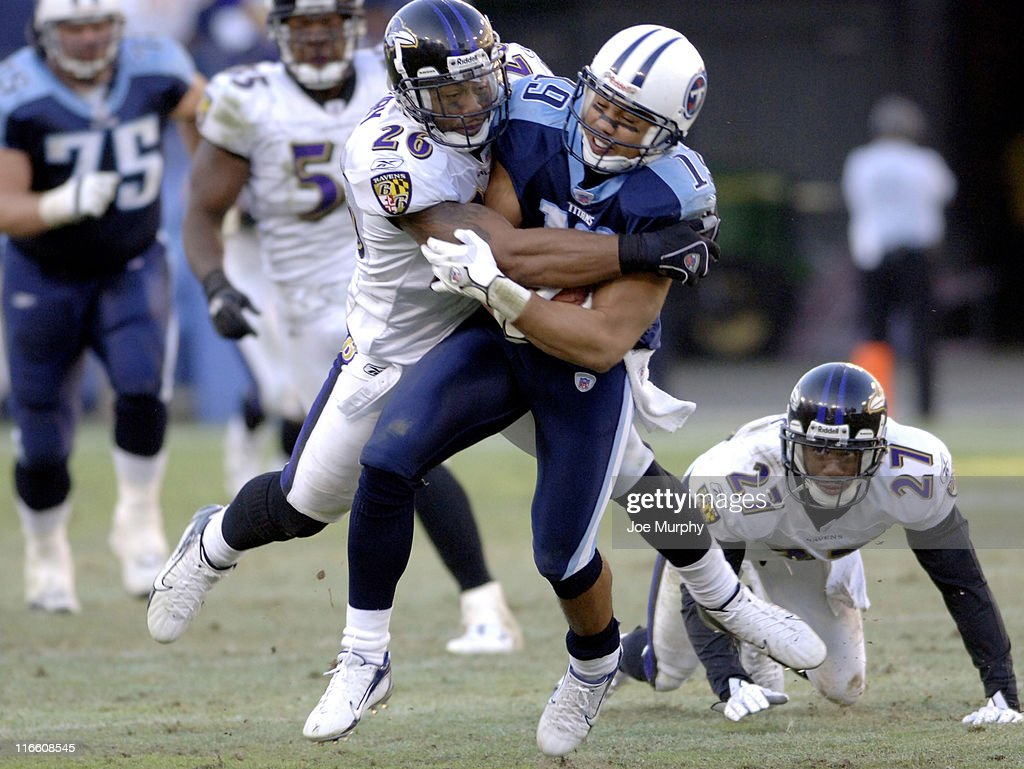 Ravens <a gi-track='captionPersonalityLinkClicked' href=/galleries/search?phrase=Dawan+Landry&family=editorial&specificpeople=575013 ng-click='$event.stopPropagation()'>Dawan Landry</a> tackles Titans Bobby Wade at LP Field, Nashville, Tennessee, November 12, 2006. The Ravens came from behind to defeat the Titans 27-26.