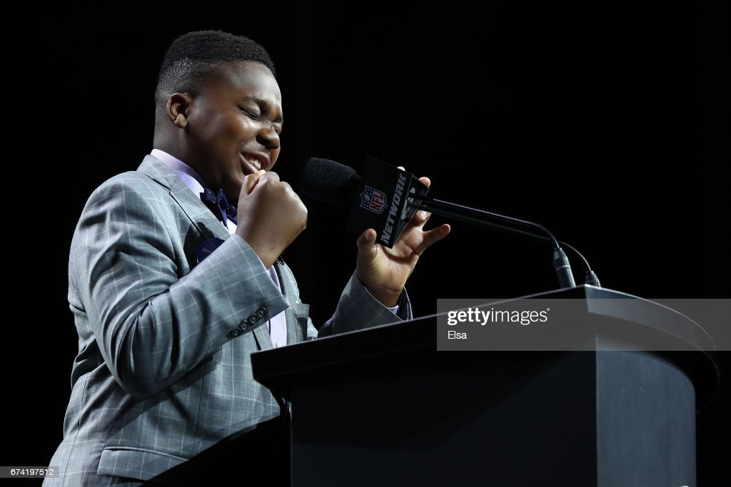 Ravens fan TJ Onwuanibe annouces Marlon Humphrey of Alabama as the #16 overall pick by the Baltimore Ravens during the first round of the 2017 NFL Draft at the Philadelphia Museum of Art on April 27, 2017 in Philadelphia, Pennsylvania.