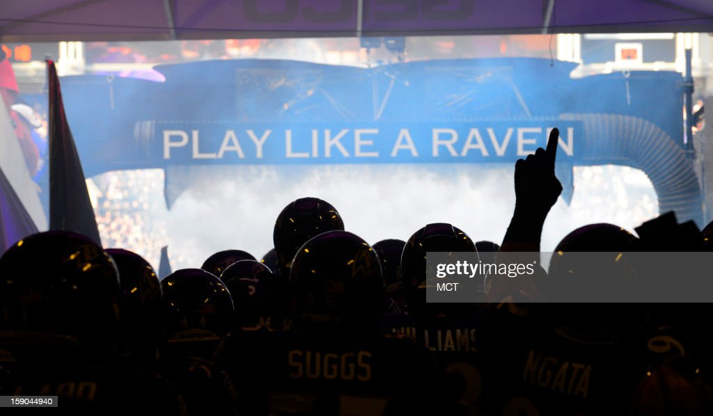 Ravens players gather in the the tunnel before their AFC playoff game against the Colts in Baltimore, Maryland, on Sunday, January 6, 2013.