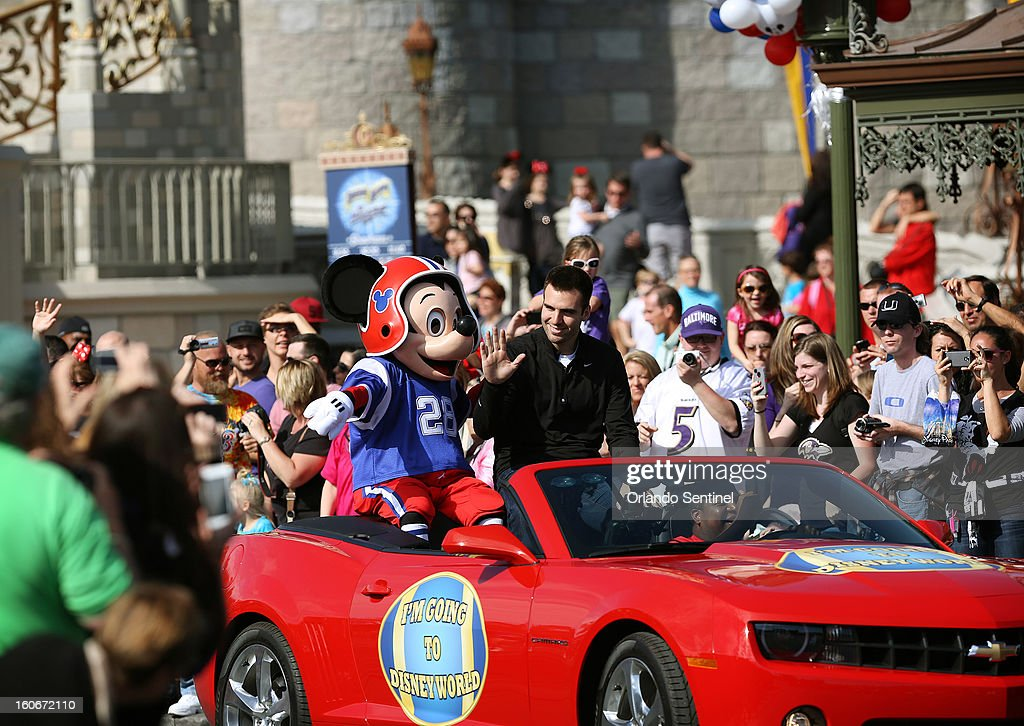 Ravens quarterback Joe Flacco, who was awarded Most Valuable Player after Baltimore won Super Bowl XLVII, rides through the Magic Kingdom in Orlando, Florida, Monday, February 4, 2013.