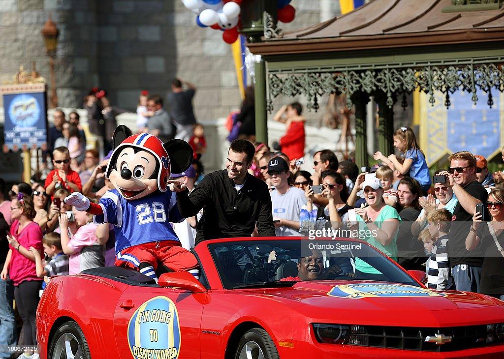 Ravens quarterback Joe Flacco, who was awarded Most Valuable Player after Baltimore won Super Bowl XLVII, rides through the Magic Kingdom in Orlando, Florida, Monday, February 4, 2013.