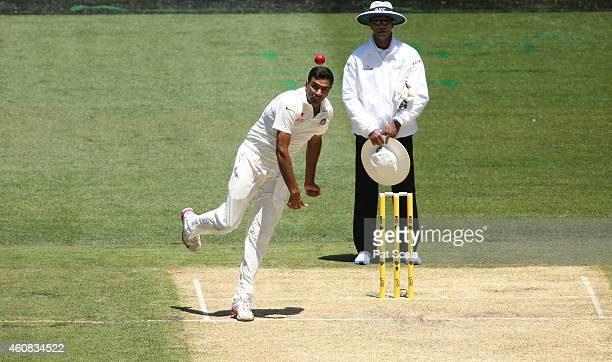 Ravi Ashwin bowling during day one of the Third Test match between Australia and India at Melbourne Cricket Ground on December 26 2014 in Melbourne...
