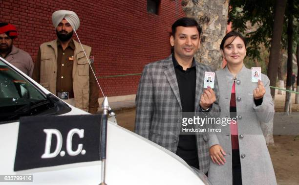 Ravi Bhagat and his wife after casting their votes at Government College for Girls on February 4 2017 in Ludhiana India Punjab on Saturday voted in...