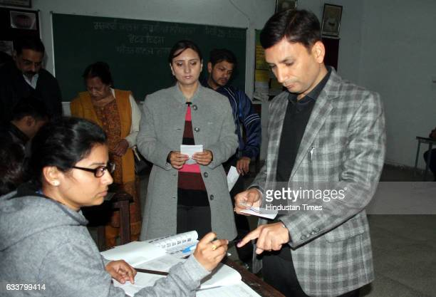 Ravi Bhagat and his wife casting their votes at Government College for Girls on February 4 2017 in Ludhiana India Punjab on Saturday voted in its...