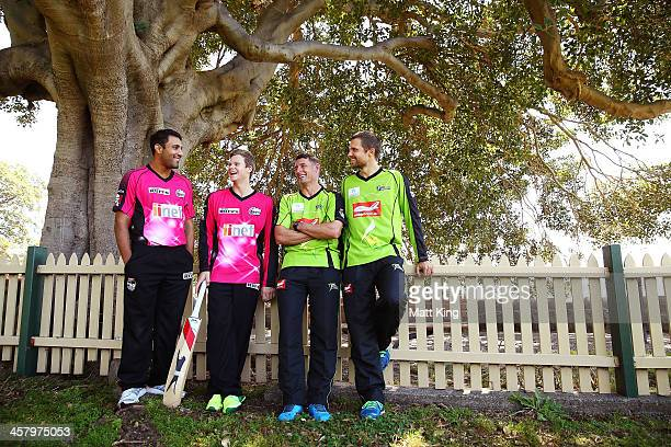 Ravi Bopara and Steve Smith of the Sixers and Mike Hussey and Dirk Nannes of the Thunder talk together during a joint Sydney Thunder and Sydney...