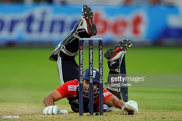 Ravi Bopara of England dives into his crease after being sent back by batting partner Graeme Swann during the 4th Natwest One Day International match...