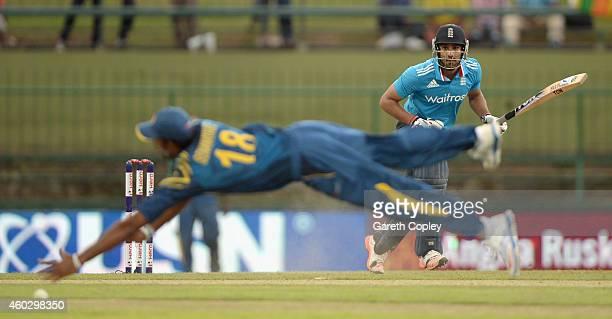 Ravi Bopara of England hits past Sachithra Senanayake of Sri Lanka during the 5th One Day International between Sri Lanka and England at Pallekele...