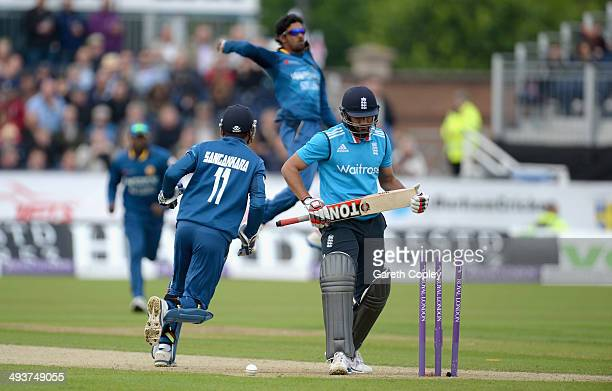 Ravi Bopara of England leaves the field after being bowled by Dhammika Prasad of Sri Lanka during the 2nd Royal London One Day International match...