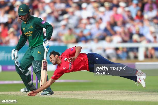 Ravi Bopara of Essex dives to field off his own bowling during the Royal London OneDay Cup Semi Final between Essex and Nottinghamshire at Cloudfm...