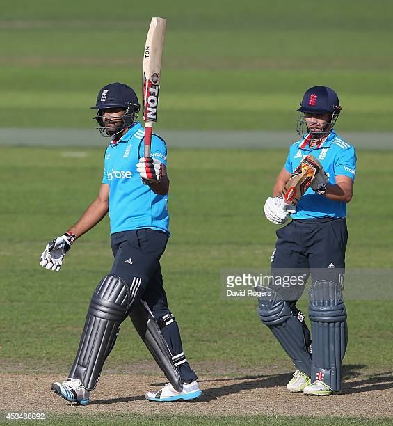 Ravi Bopara of the England Lions celebrates with team mate James Taylor after Bopara scores a century during the Triangular Series match between...