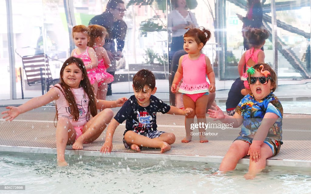 Ravi (4); Cherry (7); Ambrosia (1); Zoe (2) and Tiger (4) play in a 11 metre long swimming pool to celebrate the Australian premiere of The Pool exhibition at the National Gallery of Victoria International on August 18, 2017 in Melbourne, Australia. The exquisitely designed pool is complete with wooden decking and bespoke pool lounge chairs, with visitors invited to dangle their feet in the water and sit poolside to reflect on one of Australia's greatest cultural icons - the pool. The Pool debuted at the 2016 Venice Architecture Biennale, where it received more than 100,000 visitors.