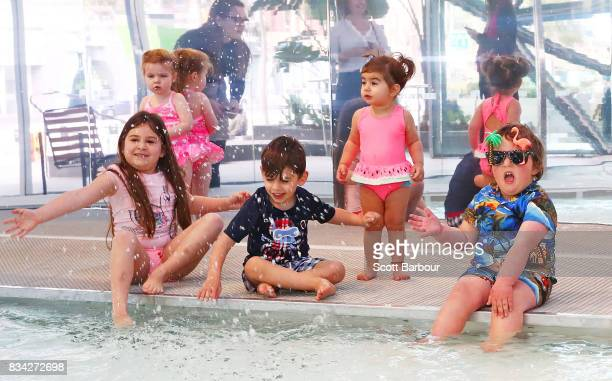 Ravi Cherry Ambrosia Zoe and Tiger play in a 11 metre long swimming pool to celebrate the Australian premiere of The Pool exhibition at the National...