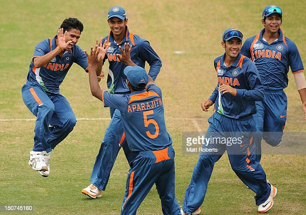 Ravi Kant Singh of India celebrates a wicket with team mates during the 2012 ICC U19 Cricket World Cup Final between Australia and India at Tony...