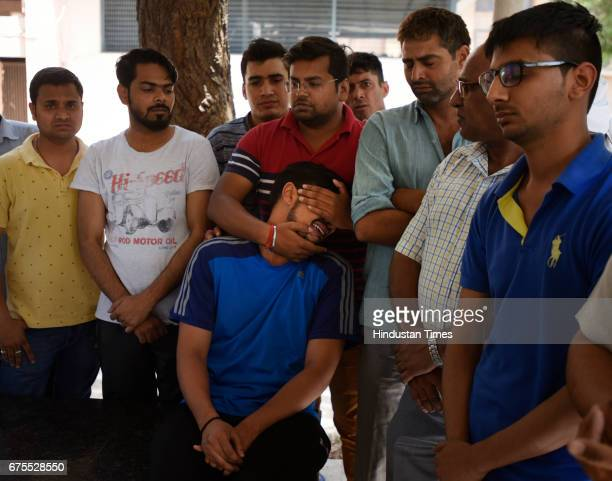Ravi Kumar son of ASI Vijay Singh Yadav who died in a gangwar last night in Mianwali area Paschim Vihar on New Delhi India Three persons including an...