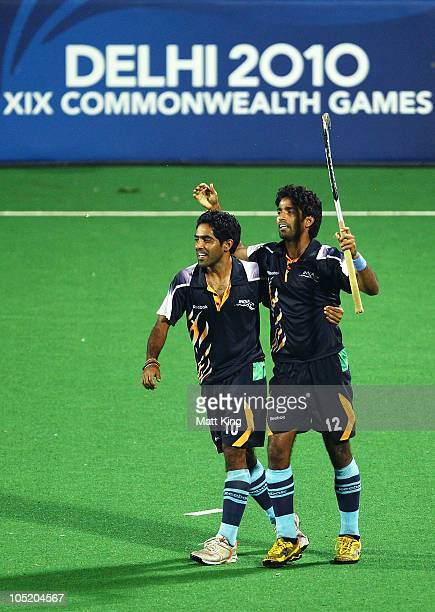 Ravi Pal and Shivendra Singh of India celebrate after India won a penalty shoot outduring the Men Semifinals Match between England and India at Major...