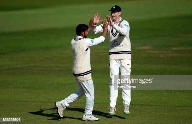 Ravi Patel and Adam Voges of Middlesex celebrate the wicket of George Bartlett of Somerset during Day One of the Specsavers County Championship...