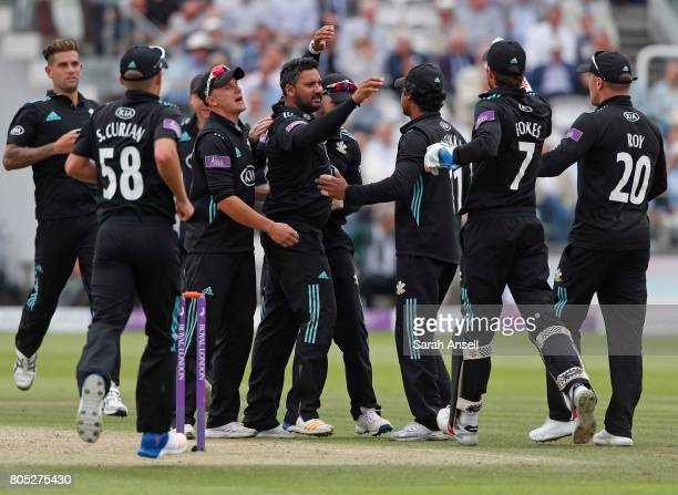 Ravi Rampaul of Surrey celebrates with teammates after taking the wicket of Nottinghamshire's Riki Wessels during the match between Nottinghamshire...
