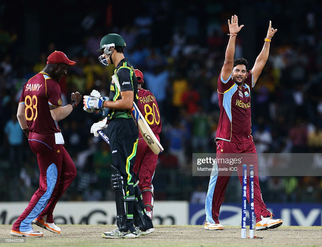 <a gi-track='captionPersonalityLinkClicked' href=/galleries/search?phrase=Ravi+Rampaul&family=editorial&specificpeople=2924536 ng-click='$event.stopPropagation()'>Ravi Rampaul</a> of the West Indies celebrates bowling <a gi-track='captionPersonalityLinkClicked' href=/galleries/search?phrase=Mitchell+Starc&family=editorial&specificpeople=6475541 ng-click='$event.stopPropagation()'>Mitchell Starc</a> of Australia during the ICC World Twenty20 2012 Semi Final match between Australia and West Indies at R. Premadasa Stadium on October 5, 2012 in Colombo, Sri Lanka.