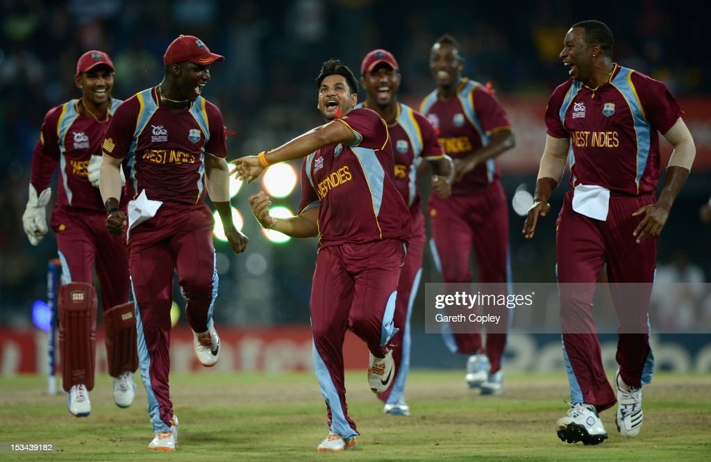 <a gi-track='captionPersonalityLinkClicked' href=/galleries/search?phrase=Ravi+Rampaul&family=editorial&specificpeople=2924536 ng-click='$event.stopPropagation()'>Ravi Rampaul</a> of the West Indies celebrates with <a gi-track='captionPersonalityLinkClicked' href=/galleries/search?phrase=Darren+Sammy&family=editorial&specificpeople=2920912 ng-click='$event.stopPropagation()'>Darren Sammy</a> and <a gi-track='captionPersonalityLinkClicked' href=/galleries/search?phrase=Kieron+Pollard&family=editorial&specificpeople=4233862 ng-click='$event.stopPropagation()'>Kieron Pollard</a> after dismissing David Hussey of Australia during the ICC World Twenty20 2012 Semi Final between Australia and the West Indies at R. Premadasa Stadium on October 5, 2012 in Colombo, Sri Lanka.