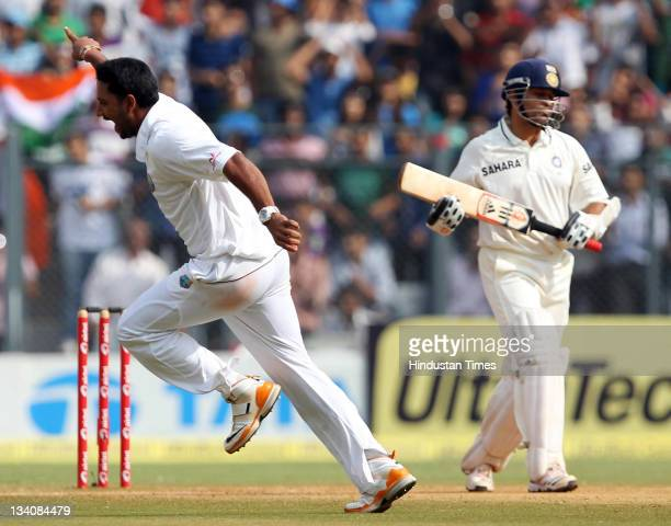 Ravi Rampaul of West Indies celebrates after taking the wicket of Indian batsman Sachin Tendulkar during the fourth day of the third test match...